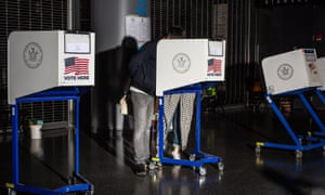 A couple place their vote at Barclays Center in Brooklyn, New York.