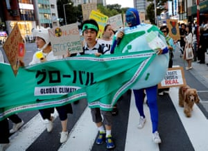 Activists march in Tokyo, Japan