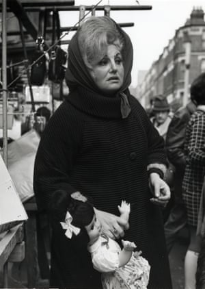 An image by Dorothy Bohm of a woman in Chapel Street Market, Islington, London in the 1960s. Bohm was sent from Lithuania to school in England in 1939.