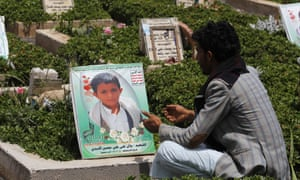 A man sits by the grave of Bilal al-Asadi, who was killed when an airstrike hit his house in Sana'a, Yemen, on 4 June 2016.