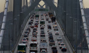 Vehicles cross the San Francisco-Oakland Bay Bridge in California.