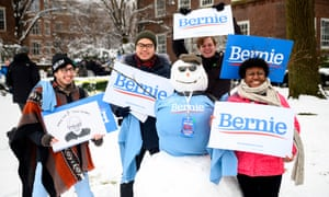 Supporters of Bernie Sanders pose with a snowman before the rally to kick off Sanders' 2020 US presidential campaign, in the Brooklyn borough of New York City.