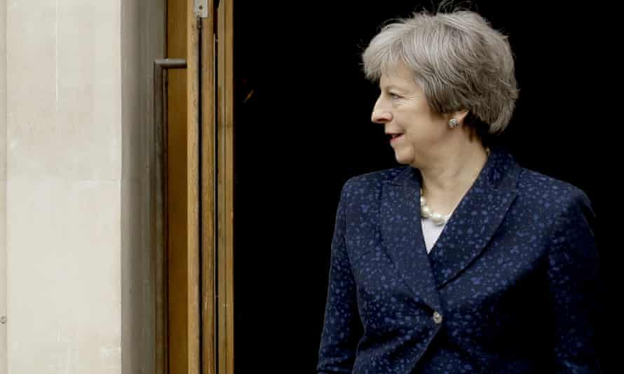 Theresa May poses for photographers after local council elections last week.