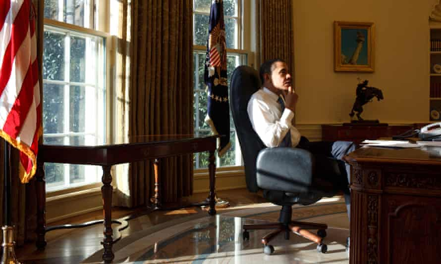 President Barack Obama in the Oval Office on his first day in office