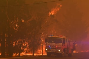 New South Wales Rural Fire Service (RFS) officers work along the Old Hume Highway near the town of Tahmoor