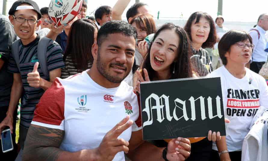 Manu Tuilagi poses with a local fan in Tokyo who watched the England training session on Tuesday.