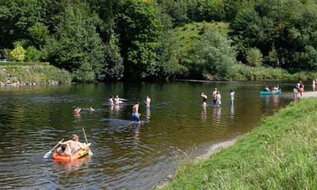 People paddling in a river
