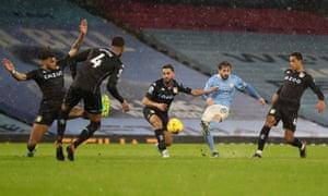 Bernardo Silva of Manchester City scores their side's first goal .