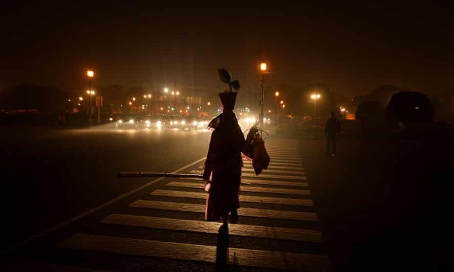 A woman crosses the road in New Delhi.