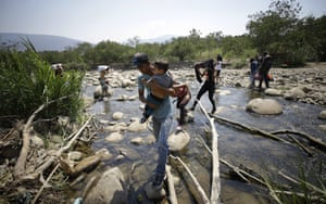 La Parada, ColombiaVenezuelans cross the Tachira River using stepping stones as they enter into Colombia illegally, near the Simon Bolivar International Bridge. Venezuela continues to keep its borders closed to keep humanitarian aid from entering