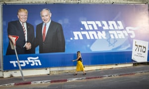 """A woman walks by an election campaign billboard for the Likud party that shows Israeli Prime Minister Benjamin Netanyahu, right, and US President Donald Trump, in Tel Aviv, Israel, Sunday, Sept 15, 2019. Hebrew on billboard reads """"Netanyahu, in another league."""" (AP Photo/Oded Balilty)"""