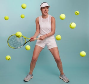 Zoe Williams with tennis rackets and lots of tennis balls