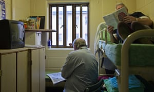 Two prisoners doubling up in a single cell at Littlehey prison in Cambridgeshire. 'Almost half of people released from prison reoffend within a year of coming out'