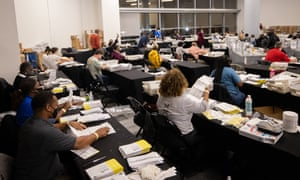 Election volunteers count absentee ballots in the swing state of Georgia in Fulton County.