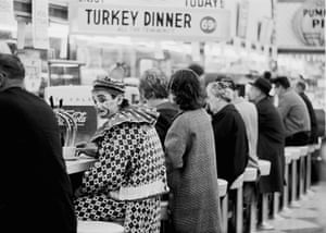 A clown at a lunch counter, Reno, Nevada, USA, 1963