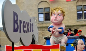 Revellers celebrate on a float carrying an effigy of Boris Johnson during a carnival parade in Cologne.