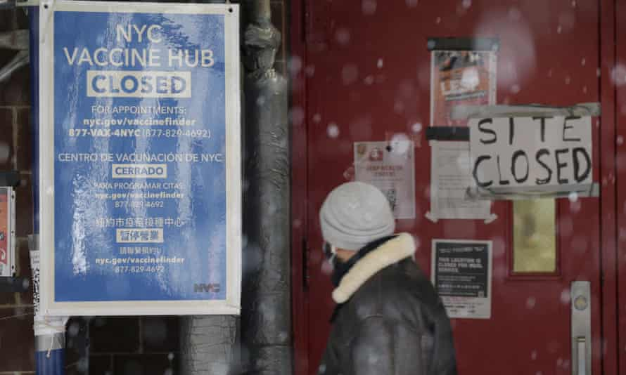 A closed sign hangs outside of a school used to distribute coronavirus vaccine in New York City on Tuesday
