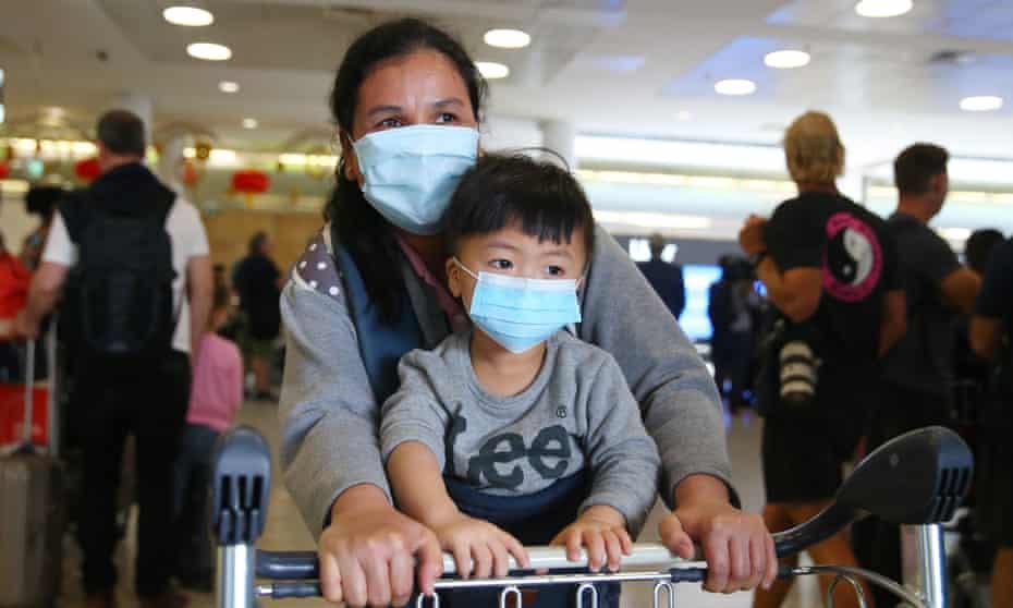 Passengers arrive at Sydney airport from Wuhan last week
