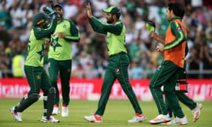 Pakistan's Babar Azam (centre) celebrates catching England's Jos Buttler.