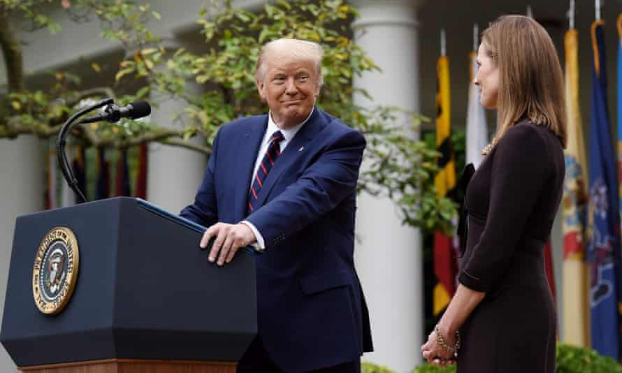 Donald Trump in the Rose Garden of the White House, alongside his supreme court nominee, Amy Coney Barrett.