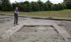 Dr Jim Leary beside the building remains at Marden Henge