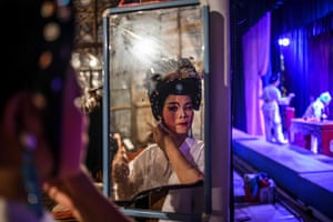 A Chiu Chow opera actor prepares for a performance during an event to mark the Hungry Ghost Festival