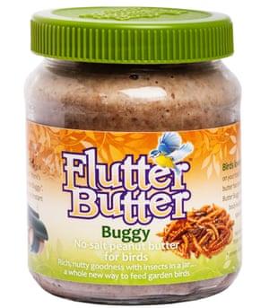 A jar of peanut butter for feeding garden birds.