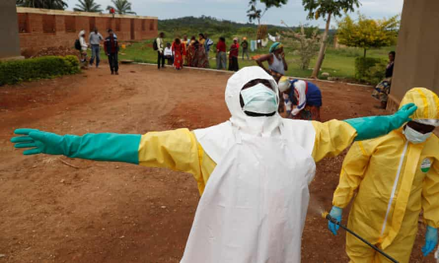 A healthcare worker is decontaminated in Beni, one of several areas of Kivu province hit by Ebola