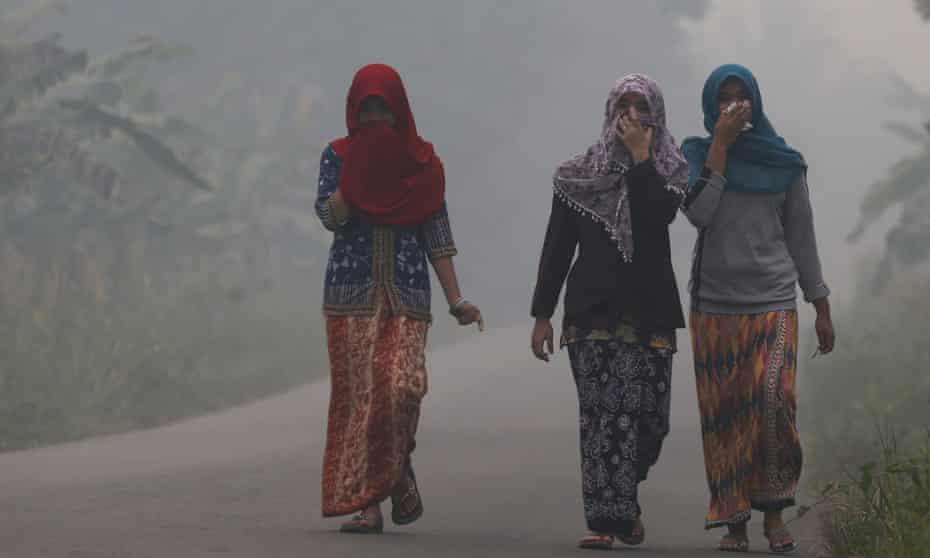 Villagers shrouded by haze on the Indonesian island of Sumatra
