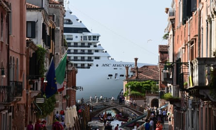 A cruise ship is seen from one of the canals leading into the Venice Lagoon.
