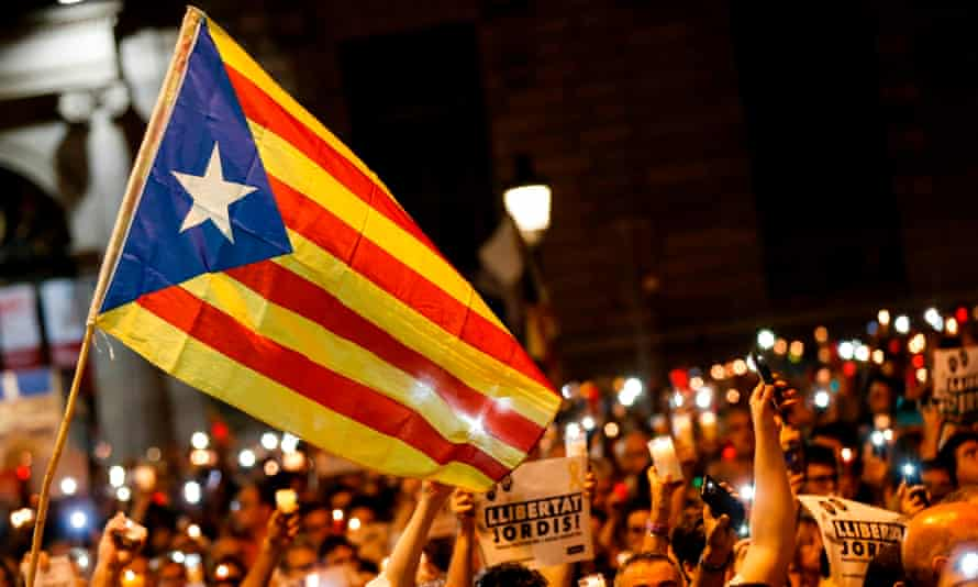 People hold candles at a Catalan pro-independence demonstration in Barcelona.