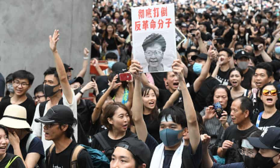 Protesters holding a picture of Carrie Lam, Hong Kong's chief executive, demonstrating against the extradition bill, which she has now declared 'dead'.
