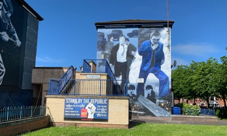 One of the Bogside murals sharing a space with a modern republican poster.
