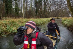 I spy ... or do I? Patrick Barkham, very early in the morning, looking for otters on the river Bure with Mark Wilkinson.