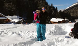 The author with one of her children in the snow