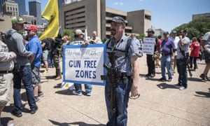 A supporter for gun rights attends a pro open carry rally outside City Hall, across from the NRA convention at Kay Bailey Hutchison Convention Center in Dallas on May 5, 2018.