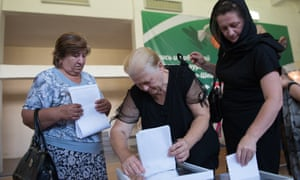 Russian citizens vote at a polling station in Russia's 2016 parliamentary election.