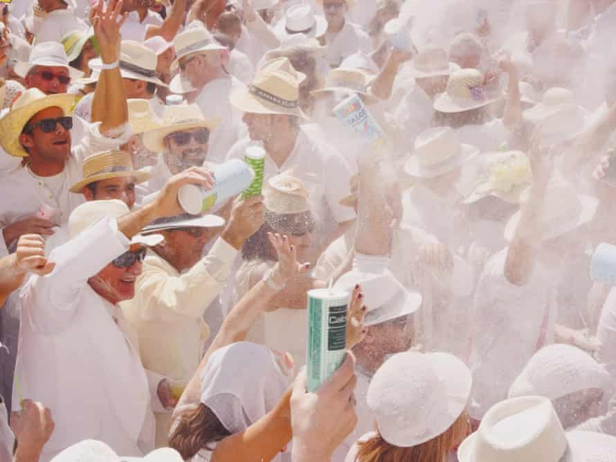 Crowds of people enjoying throwing talcum powder during the Los Indianos Party of the carnival on March 3, 2014 in Santa Cruz de La Palma, Canary Islands. Spain.