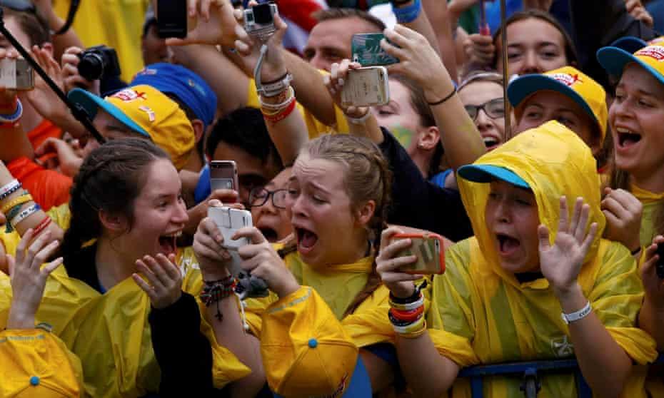 Ecstatic believers in Błonia park.