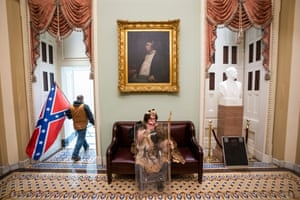 A man carries a Confederate flag outside the Senate chamber