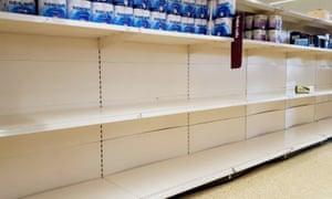 Near-empty shelves in a supermarket