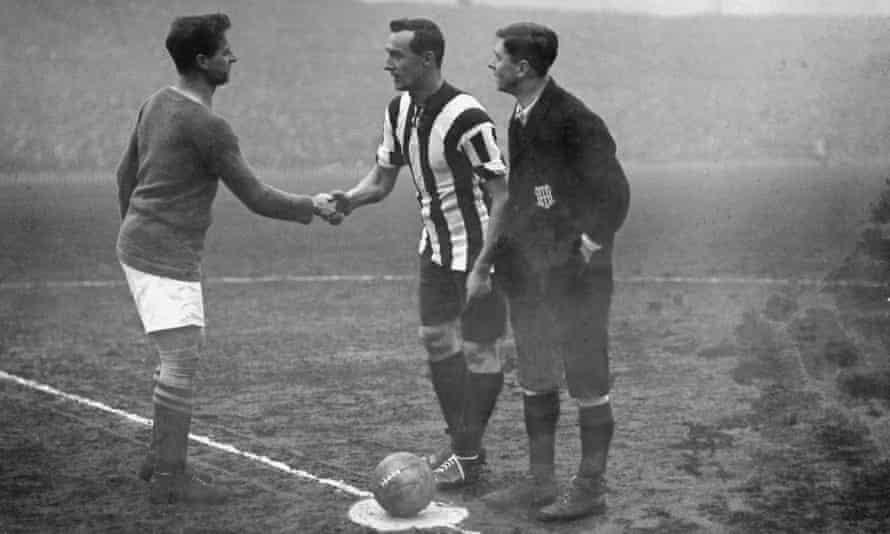 The captains of Chelsea (left) and Sheffield United shake hands before the FA Cup final at Old Trafford in April 1915, which Sheffield United won 3-0.