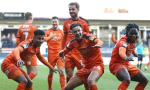 Luton's James Justin, left, celebrates with Harry Cornick and Pelly Ruddock Mpanza, right, after scoring in the win at home to Plymouth.