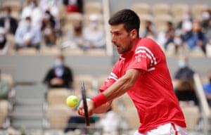Novak Djokovic plays a backhand during his victory over Ricardas Berankis.