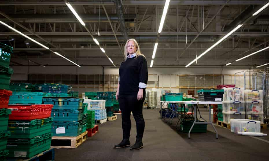 'Too many people are falling through holes …' Emma Revie in the trust's distribution warehouse in west London.