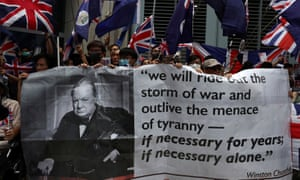 Anti-government protesters hold up banners and union flags outside the British consulate in Hong Kong.