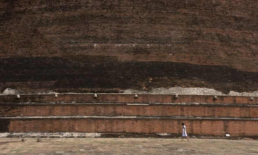 a Sri Lankan school girl walking around the Jetavanaramaya stupa