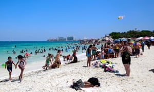 Visitors enjoy the beach in Cancun, Mexico, in April 2015.