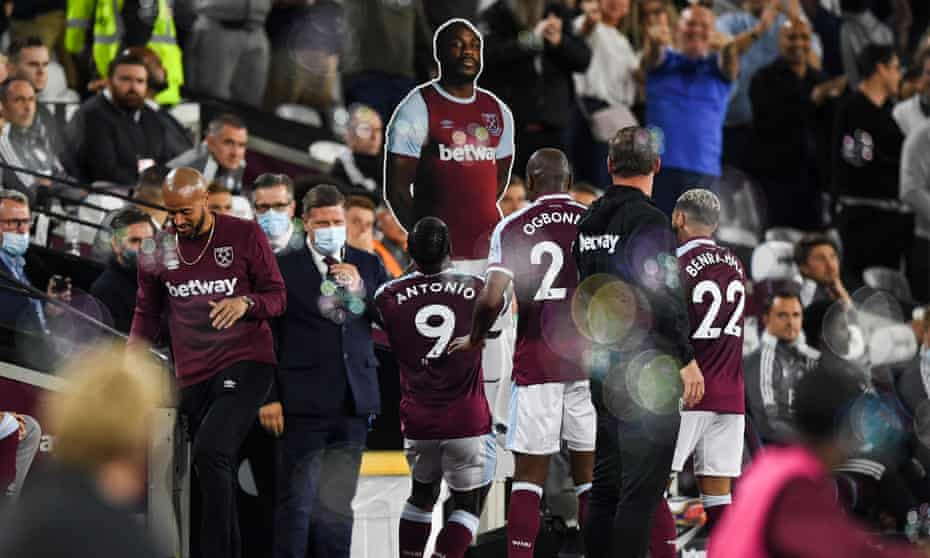 Michail Antonio celebrates with a card board cut out of himself