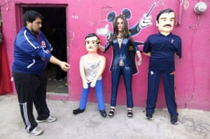 "Tamaulipas, Mexico: Pinatas depicting Mexican actress Kate del Castillo and the drug lord Joaquin ""El Chapo"" Guzman"